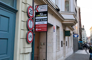 Arch in the center to pass to THE carlove rent a car office in Prague